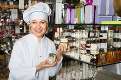 Saleswoman with sweets in jars Stock Photo