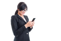 Saleswoman texting on smartphone Stock Image
