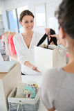 Saleswoman thanking the customer for the purchase Royalty Free Stock Image