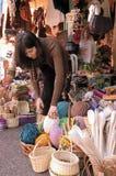Saleswoman traditional handicrafts Stock Photos