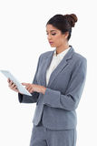 Saleswoman using tablet computer Stock Photography