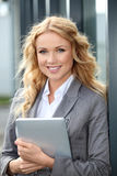 Saleswoman using touchpad Stock Images