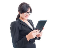 Saleswoman using a wireless tablet. Modern saleswoman using a wireless tablet isolated on white background Stock Images