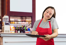 Saleswoman working at the coffee shop Stock Images