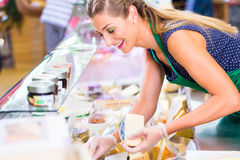 Saleswoman working at counter in groceries shop Royalty Free Stock Photo
