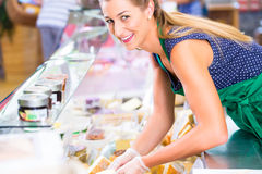 Saleswoman working at counter in groceries shop Stock Photo