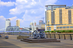 Salford Quays in Manchester. Promenade view with Millennium Bridge and modern buildings at Salford Quays in Manchester Stock Photos