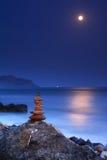 Salida de la luna sobre el mar Foto de archivo libre de regalías