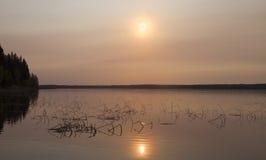 Salida del sol acuosa Fotografía de archivo