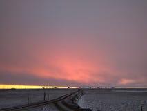 Salida del sol ardiente Imagenes de archivo