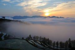Salida del sol colgante de los campos de Mingao imagen de archivo libre de regalías