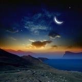 Salida del sol con la luna Foto de archivo libre de regalías