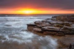 Salida del sol de la costa de Turimetta Foto de archivo libre de regalías