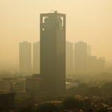 Salida del sol de la niebla con humo Imágenes de archivo libres de regalías