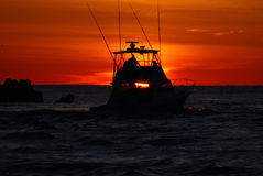 Salida del sol de la pesca Foto de archivo