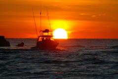 Salida del sol de la pesca Foto de archivo libre de regalías