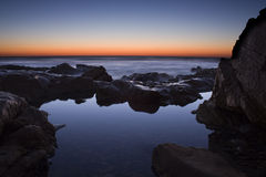 Salida del sol de la piscina de la roca Fotografía de archivo libre de regalías