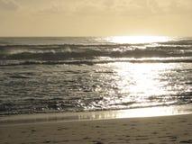 Salida del sol de la playa Fotografía de archivo libre de regalías