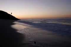 Salida del sol de la playa imagenes de archivo
