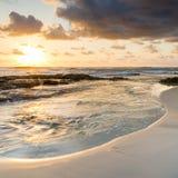 Salida del sol de la playa Imagen de archivo libre de regalías