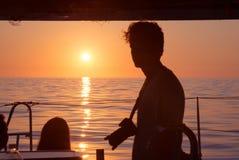 Salida del sol de la silueta del fotógrafo Foto de archivo