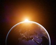 Salida del sol de la tierra del planeta Foto de archivo libre de regalías