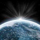 Salida del sol de la tierra - exploración del universo Foto de archivo
