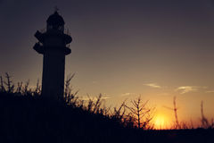 Salida del sol de Lightgouse Imagen de archivo libre de regalías