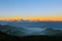 Salida del sol de Minya Konka con el mar de nubes Imagenes de archivo