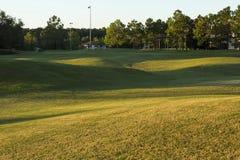 Salida del sol del campo de golf e hierba ajardinada orlando Imagenes de archivo