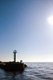 Salida del sol del faro del embarcadero del puerto de Darlowo Imagen de archivo