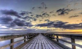 Salida del sol del invierno en un embarcadero Fotos de archivo libres de regalías