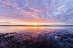 Salida del sol del lago Foto de archivo libre de regalías