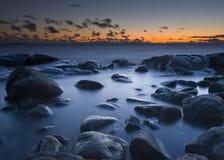 Salida del sol del mar Imagen de archivo libre de regalías