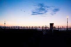 Salida del sol del paseo marítimo Fotos de archivo libres de regalías