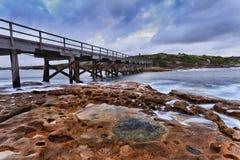 Salida del sol desnuda del puente del océano Fotografía de archivo libre de regalías