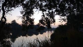 Salida del sol en The Creek Imagen de archivo libre de regalías