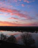 Salida del sol en el agua Imagen de archivo libre de regalías
