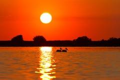 Salida del sol en el delta de Danubio Foto de archivo libre de regalías