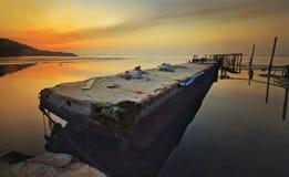 Salida del sol en el embarcadero quebrado Penang fotografía de archivo
