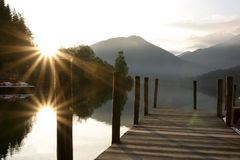 Salida del sol en el lago Imagenes de archivo