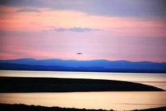 Salida del sol en el lago DaliNuoer Imagenes de archivo