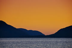 Salida del sol en el lago George Fotografía de archivo