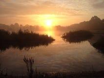 Salida del sol en la charca holandesa Imagen de archivo