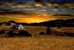 Salida del sol en la granja Imagen de archivo libre de regalías