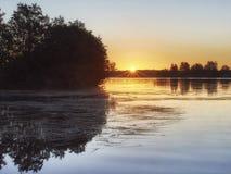 Salida del sol en la isla de Eglov Fotos de archivo