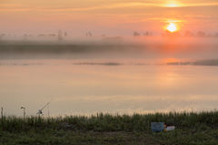 Salida del sol en la niebla Imágenes de archivo libres de regalías
