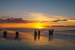Salida del sol en la playa de la locura Imagen de archivo