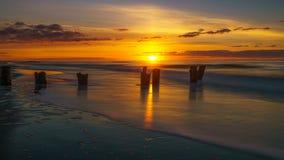 Salida del sol en la playa de la locura Imagen de archivo libre de regalías