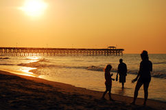 Salida del sol en la playa de Myrlte Imagen de archivo libre de regalías